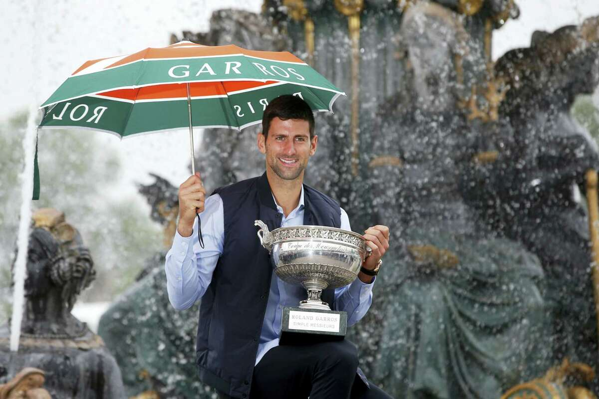 Novak Djokovic poses with the French Open trophy during a photo session at the Place de la Concorde, in Paris on Monday.