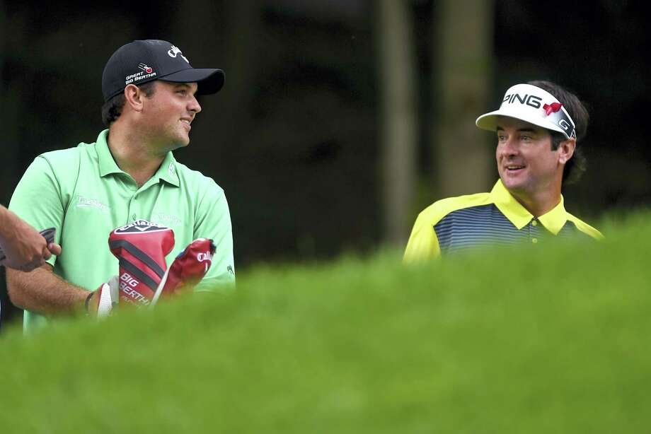Patrick Reed and Bubba Watson have a laugh at the 15th tee box during the third round on Saturday. Photo: Brad Horrigan — Hartford Courant Via AP  / Hartford Courant