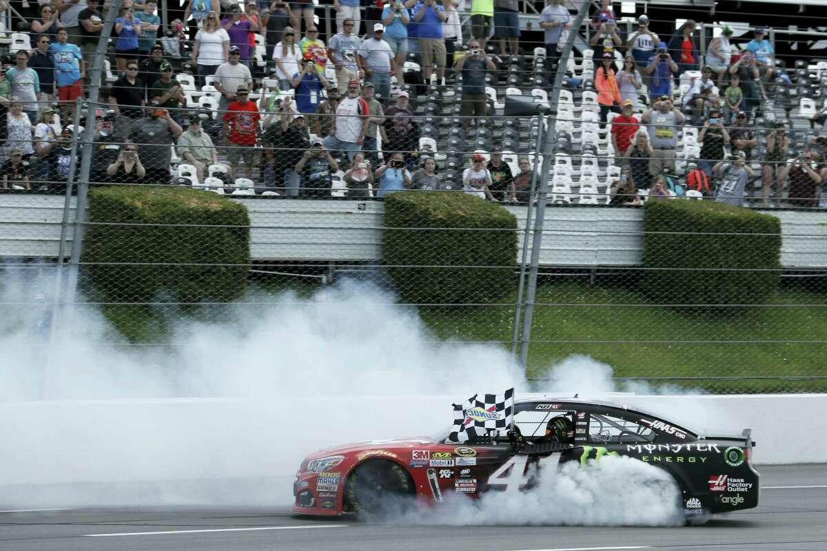Kurt Busch celebrates after winning at Pocono Raceway on Monday.