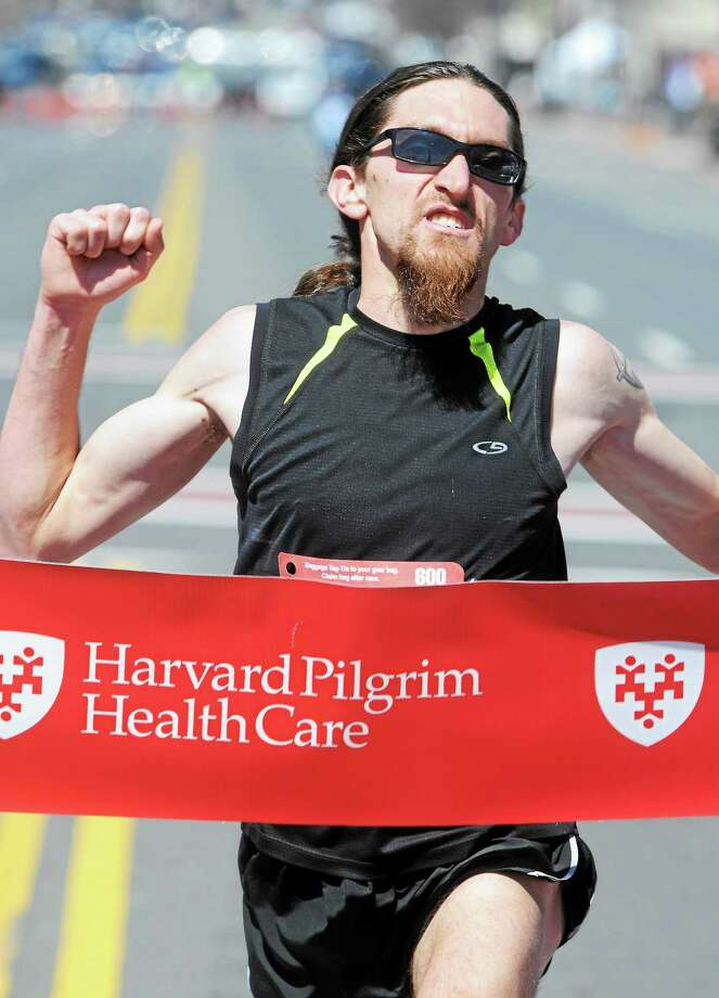 The men's winner of Middletown's 2014 Harvard Pilgrim Half-Marathon was Will Sanders of Wethersfield. Photo: File Photo  / Mara Lavitt