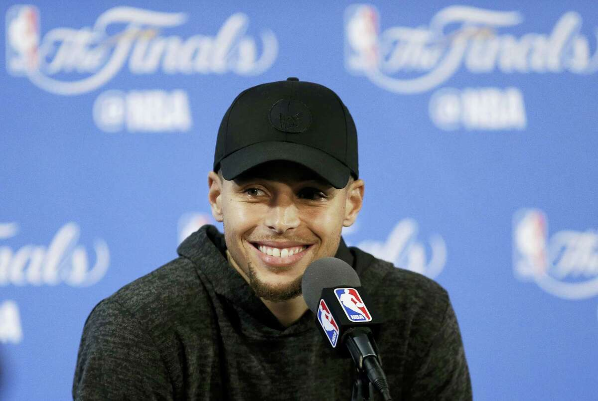 Stephen Curry smiles at a news conference after Game 2 of the NBA Finals on Sunday.