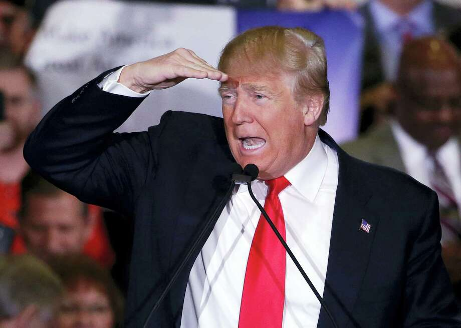 """In this Feb. 23, 2016 photo, Republican presidential candidate Donald Trump looks out onto the crowd during a rally in Reno, Nev. After winning the Nevada caucuses, the Republican presidential front-runner said he loved the """"poorly educated."""" Photo: AP Photo/Marcio Jose Sanchez, File  / AP"""