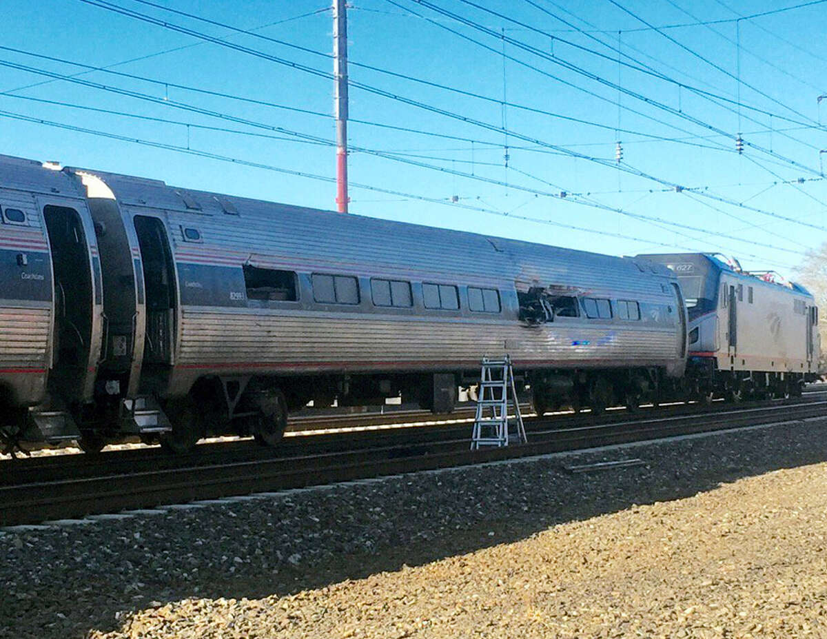 This photo shows an Amtrak train following an accident Sunday, April 3, 2016 in Chester, Pa. Amtrak said the train was heading from New York to Savannah, Ga., when it struck a backhoe outside of Philadelphia.