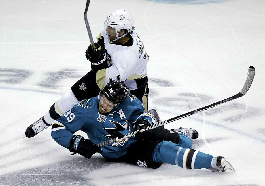 The Penguins' Matt Cullen, top, collides with the Sharks' Logan Couture during the first on Monday. Photo: Eric Risberg — The Associated Press  / Copyright 2016 The Associated Press. All rights reserved. This material may not be published, broadcast, rewritten or redistribu