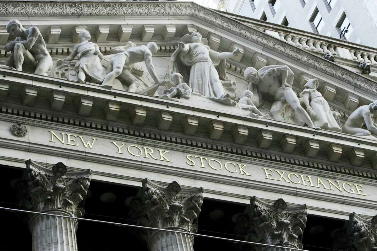 This Tuesday, Oct. 11, 2016, photo shows the New York Stock Exchange. Technology stocks led a broad reverse in global markets on Wednesday after Samsung downgraded its profit estimates and networks company Ericsson warned on its outlook. Investors will later look to the minutes of the U.S. Federal Reserve's last meeting for hints on how quickly interest rates might be raised.