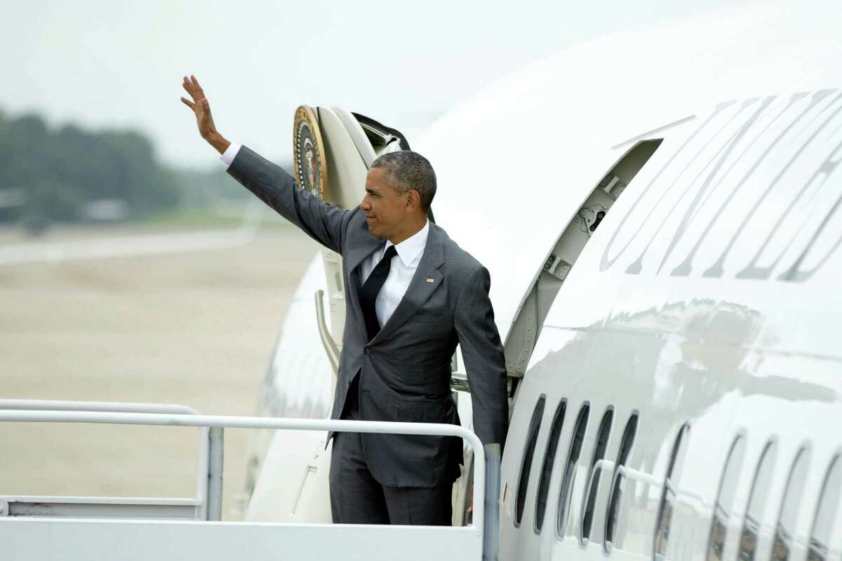 President Barack Obama waved as he boarded Air Force One at Andrews Air Force Base, Maryland, on Friday to travel to Miami for a Democratic Senatorial Campaign Committee roundtable and a DNC event.