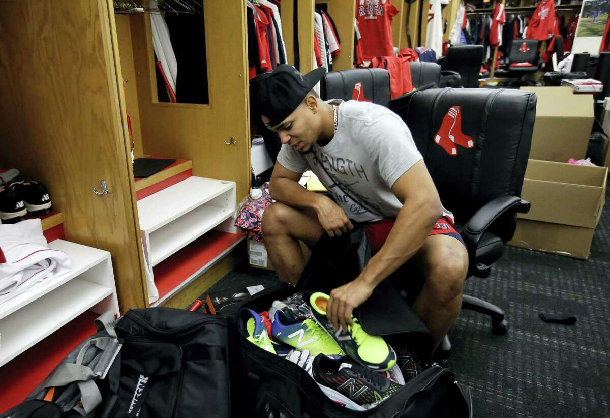 Boston Red Sox shortstop Xander Bogaerts cleans out his locker in the team's clubhouse at Fenway Park Tuesday The Indians swept the Red Sox out of the postseason, completing a three-game American League Division Series.