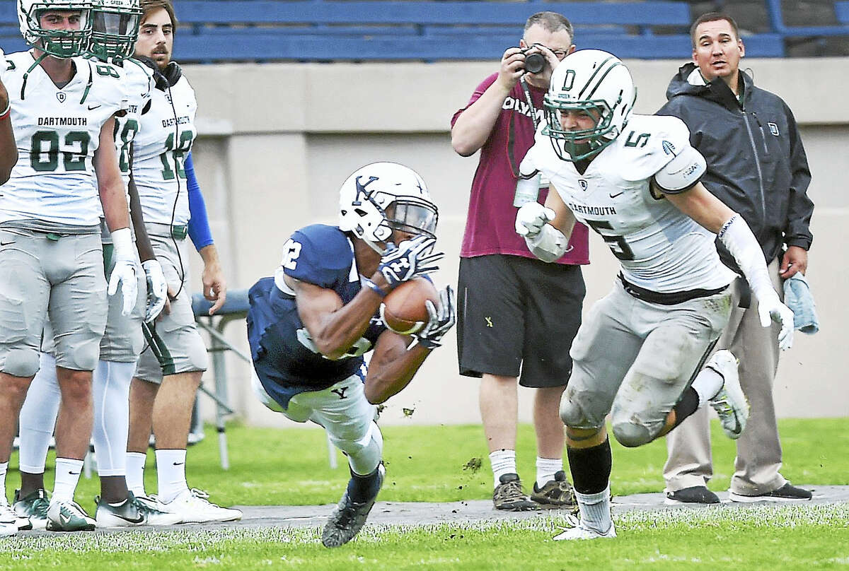 (Arnold Gold-New Haven Register) Myles Gaines (center) of Yale dives for a catch in the second period against Dartmouth at the Yale Bowl on 10/8/2016.