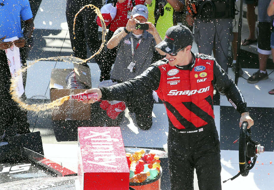 Joey Logano (12) celebrates in victory lane after winning the NASCAR Xfinity race at Watkins Glen International on Saturday. Photo: Mel Evans — The Associated Press  / Copyright 2016 The Associated Press. All rights reserved. This material may not be published, broadcast, rewritten or redistribu