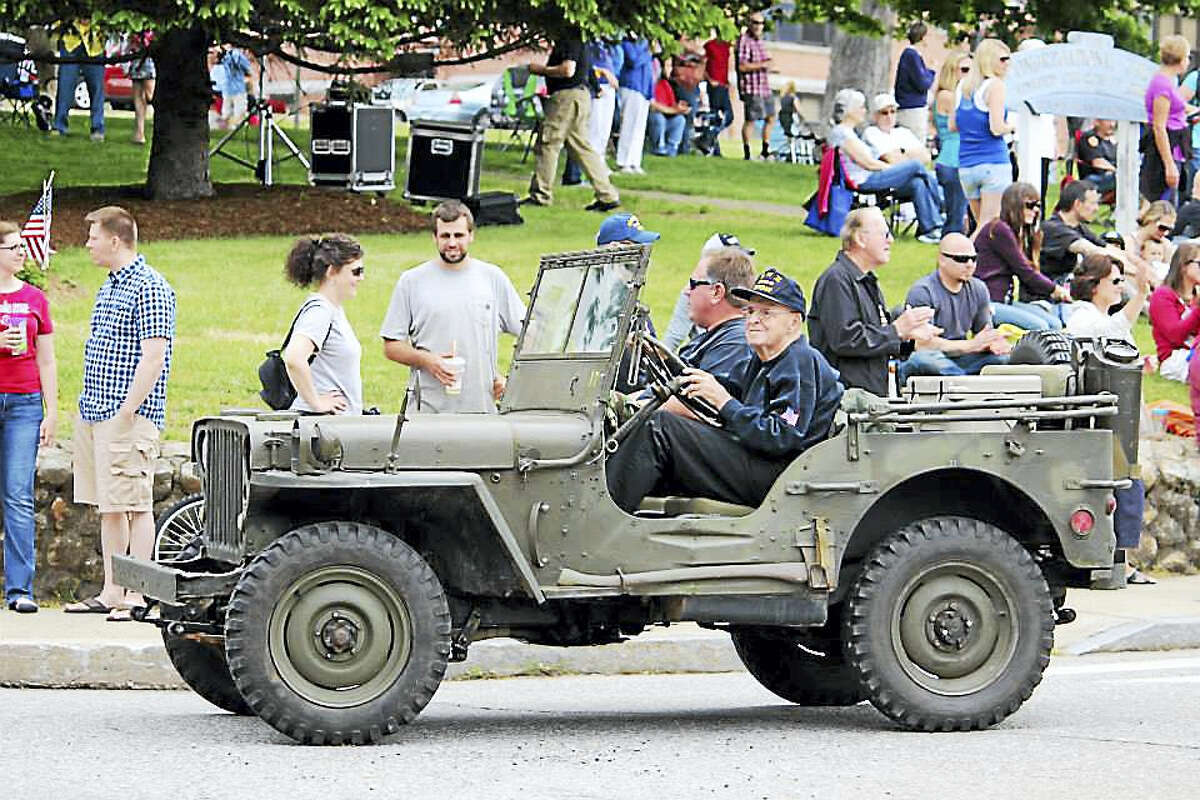 Bill Reardon, a member of the Belltown Antique Car Club in East Hampton, took part in last year's Old Home Day celebration, representing the Connecticut Military Vehicle Collectors club.