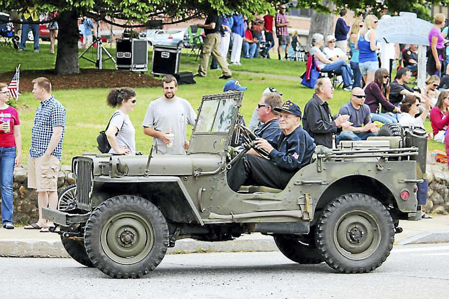 Bill Reardon, a member of the Belltown Antique Car Club in East Hampton, took part in last year's Old Home Day celebration, representing the Connecticut Military Vehicle Collectors club. Photo: Courtesy Photo