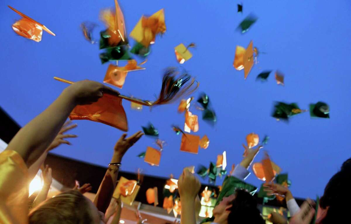 York Catholic graduates toss their caps in the air after commencement at York Catholic on Wednesday, May 28, 2014. York Catholic graduated 107 seniors in its 2014 commencement ceremony. Chris Dunn ?' Daily Record/Sunday News