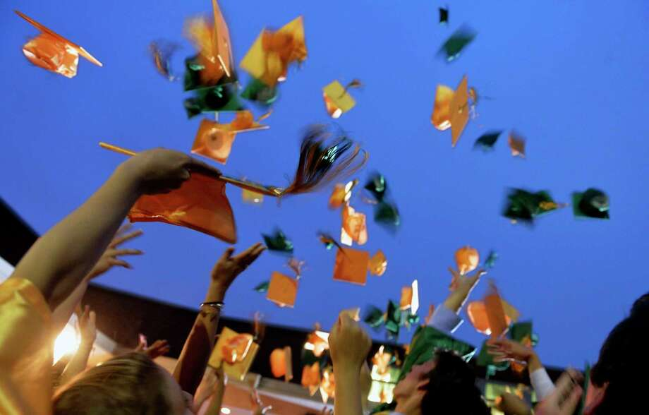 York Catholic graduates toss their caps in the air after commencement at York Catholic on Wednesday, May 28, 2014. York Catholic graduated 107 seniors in its 2014 commencement ceremony. Chris Dunn Ñ Daily Record/Sunday News / © 2014 by The York Daily Record/Sunday News