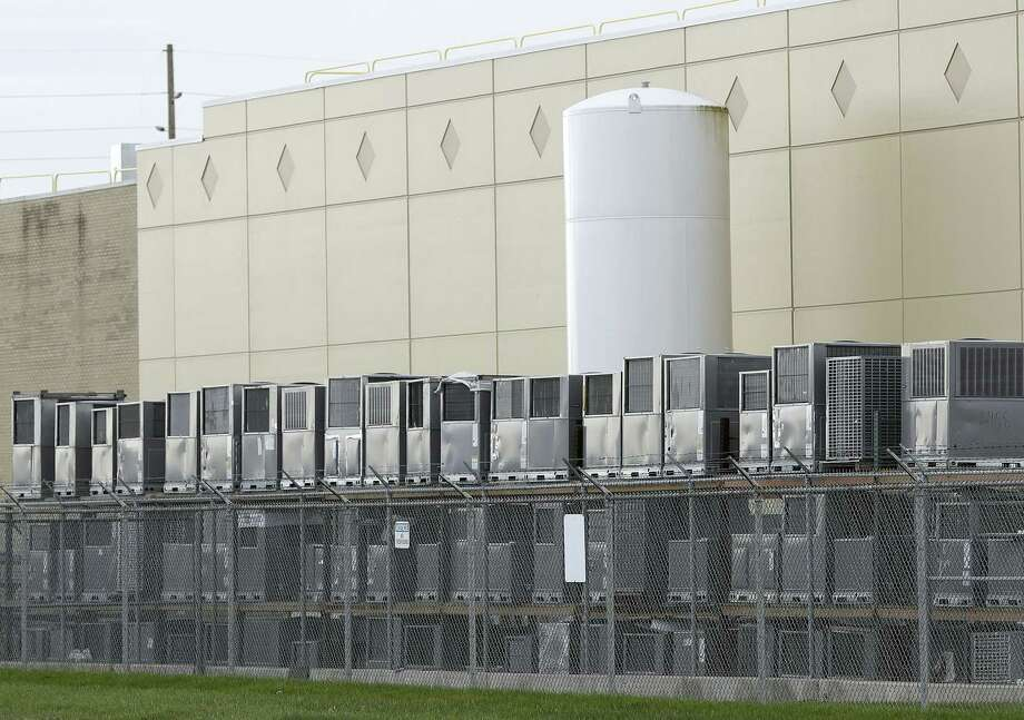Air conditioning units are stacked outside the Carrier Corp. plant Nov. 30 in Indianapolis. Carrier and President-elect Donald Trump reached an agreement to keep nearly 1,000 jobs in Indiana. Photo: AP Photo — Darron Cummings   / Copyright 2016 The Associated Press. All rights reserved.