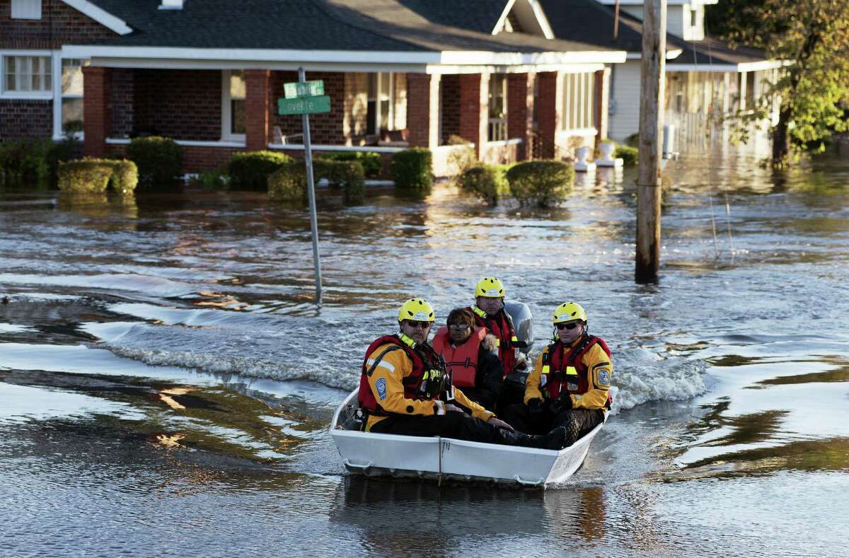 AP Photo/Mike Spencer A swift water rescue team transports a resident of to safety on a street covered with floodwaters caused by rain from Hurricane Matthew in Lumberton, N.C., Monday, Oct. 10, 2016.