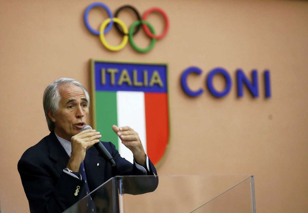Italian Olympic Committee President Giovanni Malago' speaks during a press conference in Rome, Tuesday, Oct. 11, 2016. The Italian Olympic Committee is suspending Rome's bid for the 2024 Games for the time being, while leaving open the possibility for a revival of the candidacy if there is a change in city government.