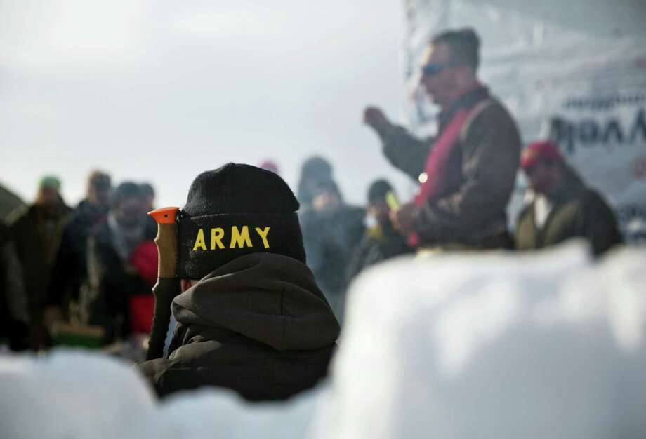 An Army veteran attends a briefing for fellow veterans at the Oceti Sakowin camp where people have gathered to protest the Dakota Access oil pipeline in Cannon Ball, N.D. on Dec. 3, 2016. Photo: AP Photo/David Goldman  / Copyright 2016 The Associated Press. All rights reserved.