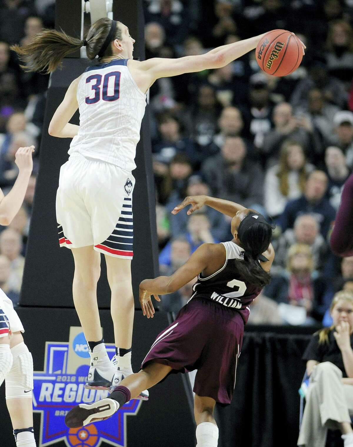 UConn's Breanna Stewart, left, blocks a shot by Mississippi State's Morgan William during the regional semifinals in Bridgeport.