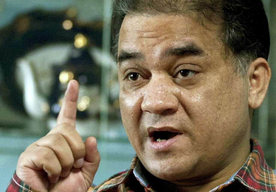 In this Feb. 4, 2013 photo, Ilham Tohti, an outspoken scholar of China's Uighur minority, gestures as he speaks during an interview at his home in Beijing, China. A group of leading rights organizations has awarded its annual prize for human rights defenders to imprisoned Chinese Muslim minority economics professor Tohti, shining new attention on a case that has brought strong international condemnation. Photo: AP Photo/Andy Wong, File  / Copyright 2016 The Associated Press. All rights reserved.