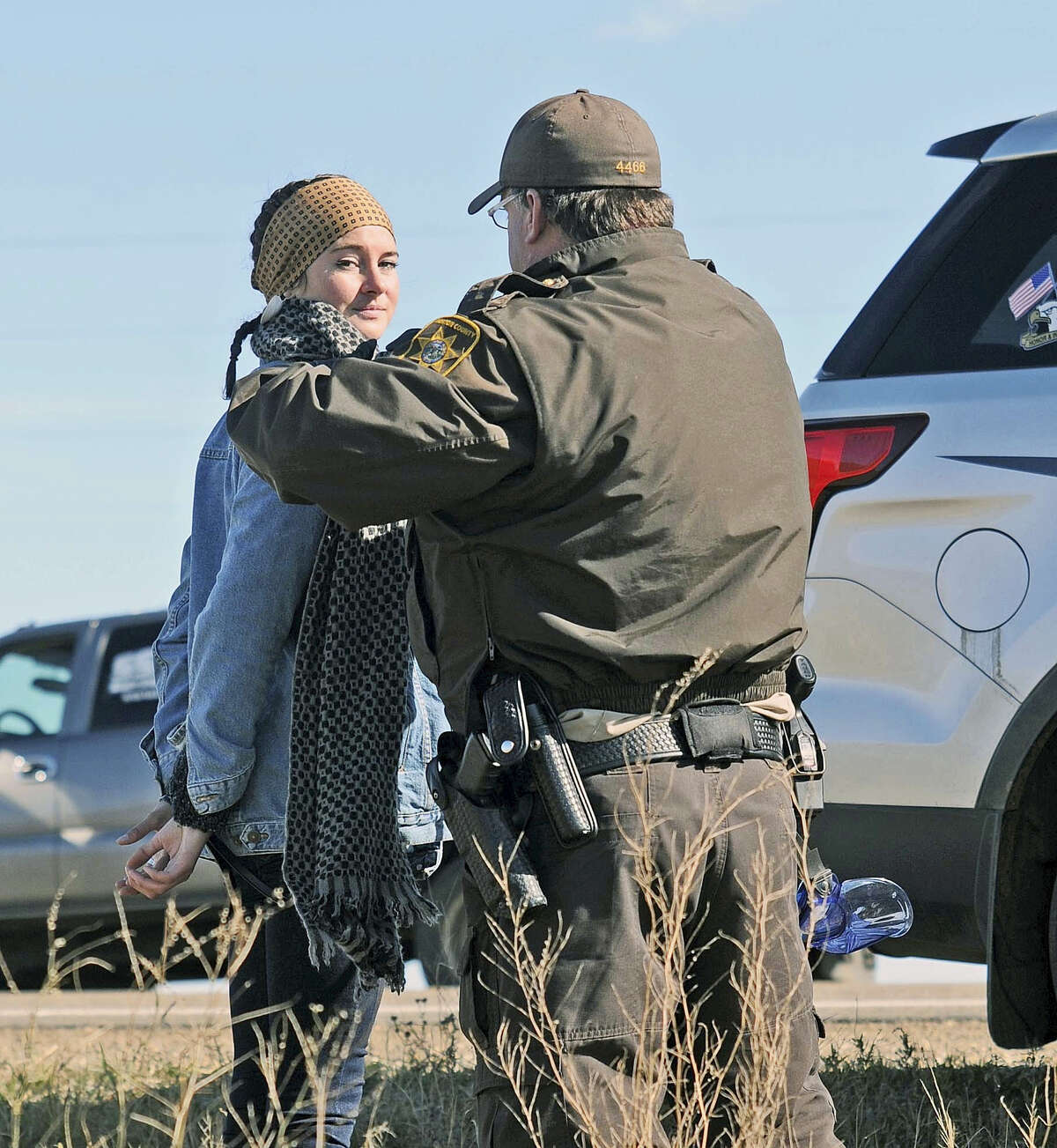A Morton County Sheriff's deputy officer arrests actress Shailene Woodley at a protest against the Dakota Access Pipeline near St. Anthony, N.D. on Oct. 10, 2016. The U.S. Army Corps of Engineers won't yet authorize construction of the $3.8 billion, four-state Dakota Access oil pipeline on federal land in southern North Dakota, it said Monday, along with reiterating its earlier request that the pipeline company voluntarily stop work on private land in the area.