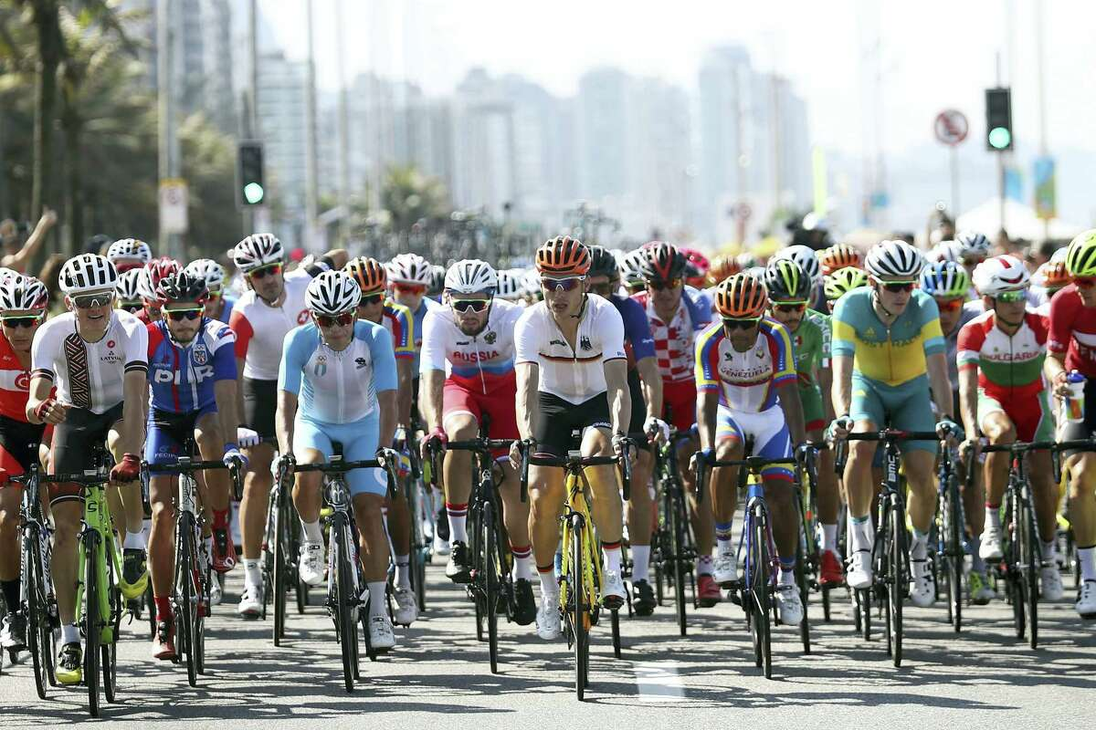 Germany's Tony Martin, front center, rides in the peloton during the men's road cycling race along Copacabana beach at the Summer Olympics in Rio de Janeiro on Saturday.
