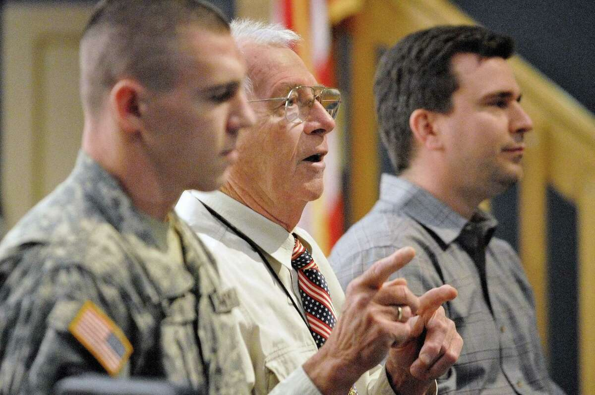 Portland resident Retired Army Lt. Col. Reg Farrington, center, speaks to high school sophomores in the social studies class at the Portland High School Veterans Day program in 2013. Specialist Nick Case, left, and former Navy Nuclear Technician Wayne Kukucka also served on the panel of veterans.