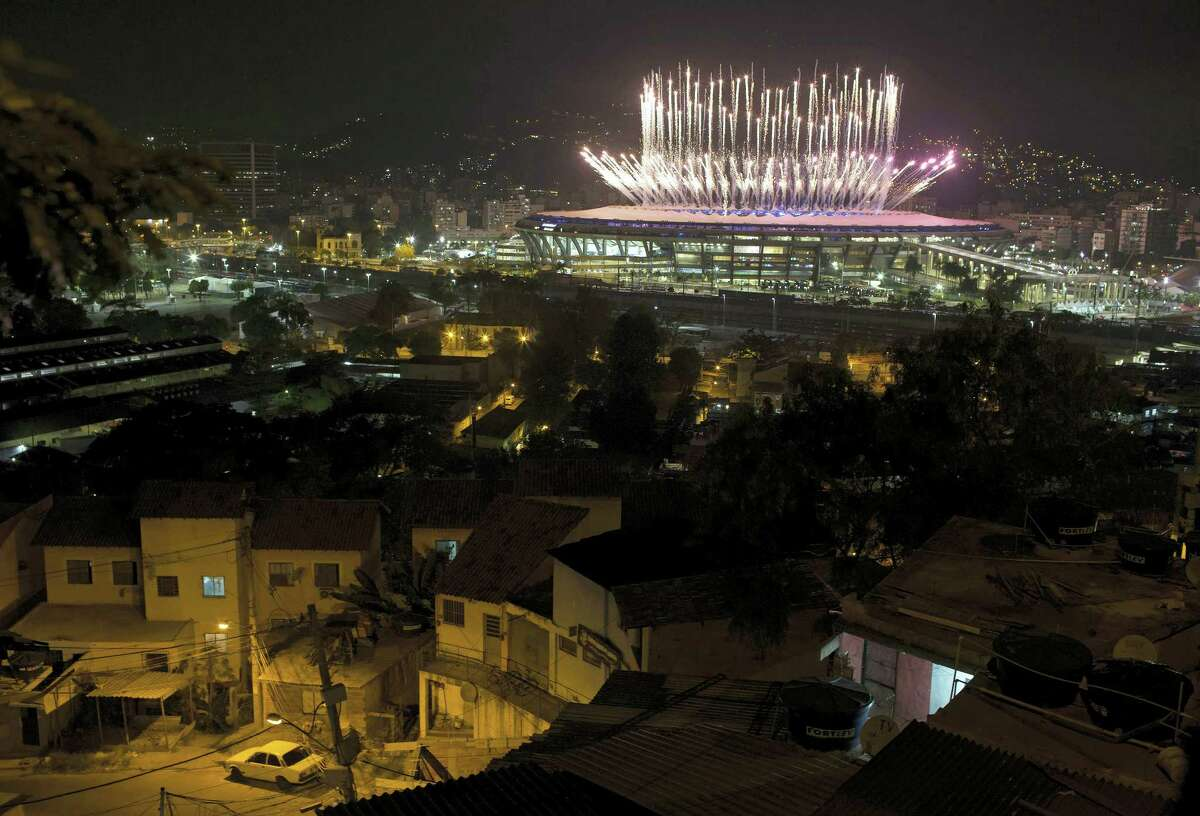 The Mangueira slum is backdropped by fireworks exploding above the Maracana stadium during the opening ceremony of the Rio's 2016 Summer Olympics in Rio de Janeiro in Rio de Janeiro, Brazil, Friday, Aug. 5, 2016.