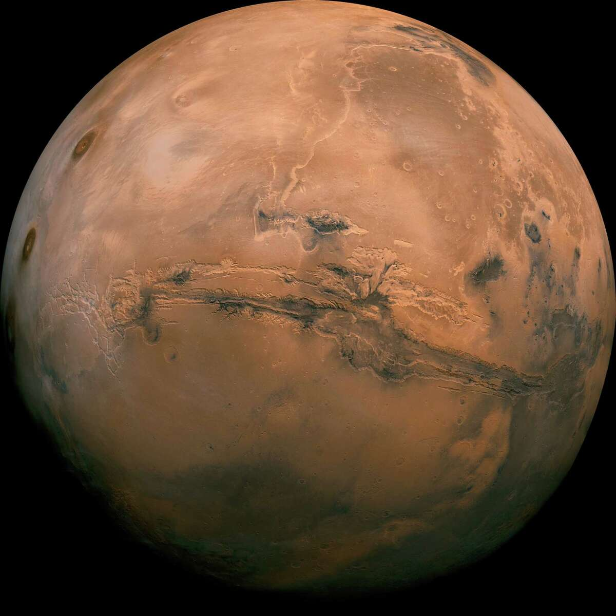 This image provided by NASA shows the plant Mars. President Barack Obama sought on Oct. 11, 2016 to reinvigorate his call for the U.S. to send humans to Mars by the 2030s, showcasing budding partnerships between the U.S. government and commercial companies to develop spacecraft capable of carrying out the extraterrestrial mission.