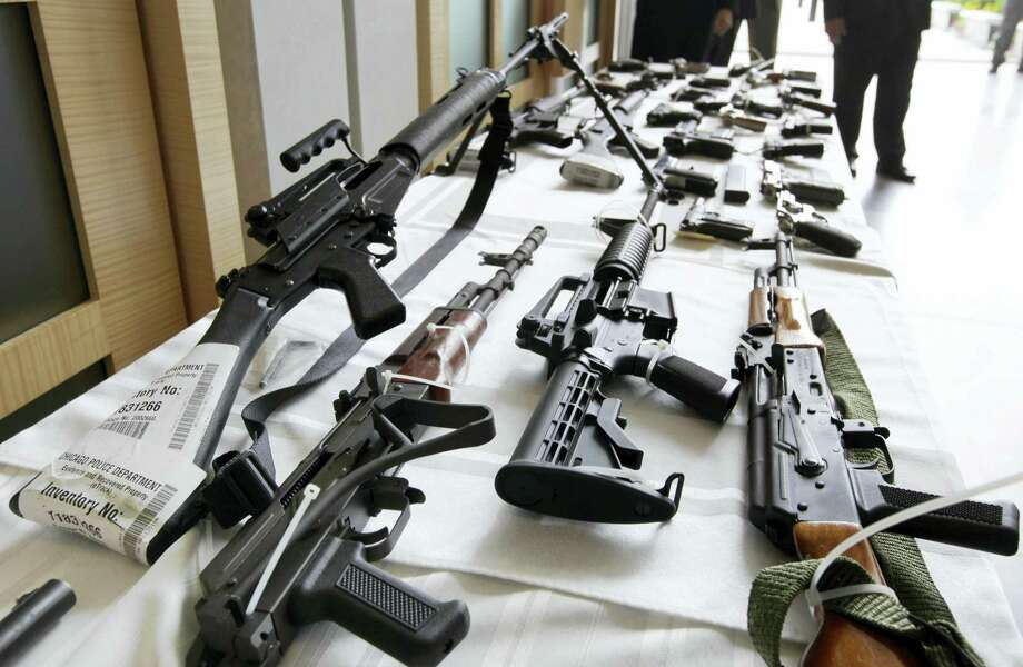 In this July 22, 2010, file photo, various guns are displayed at the Chicago FBI office. A new poll shows most young adults across racial and ethnic groups support tighter gun polices including background checks, stricter penalties for gun law violations, and banning semi-automatic weapons. In the new GenForward poll, about 9 in 10 young adults say they support criminal background checks for all gun sales, a level of support that remains consistent across racial and ethnic groups. Photo: AP Photo/M. Spencer Green, File   / AP2010