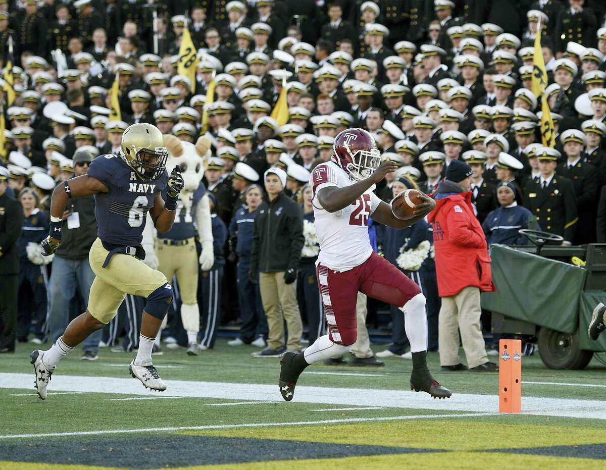 Temple running back Ryquell Armstead runs for a touchdown past Navy safety Sean Williams during the second half Saturday in Annapolis, Md.