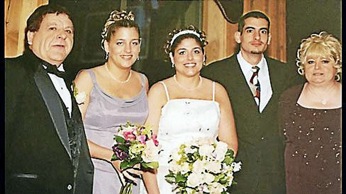 Paula Milardo on the far right with her three children and husband Tony on the far left.