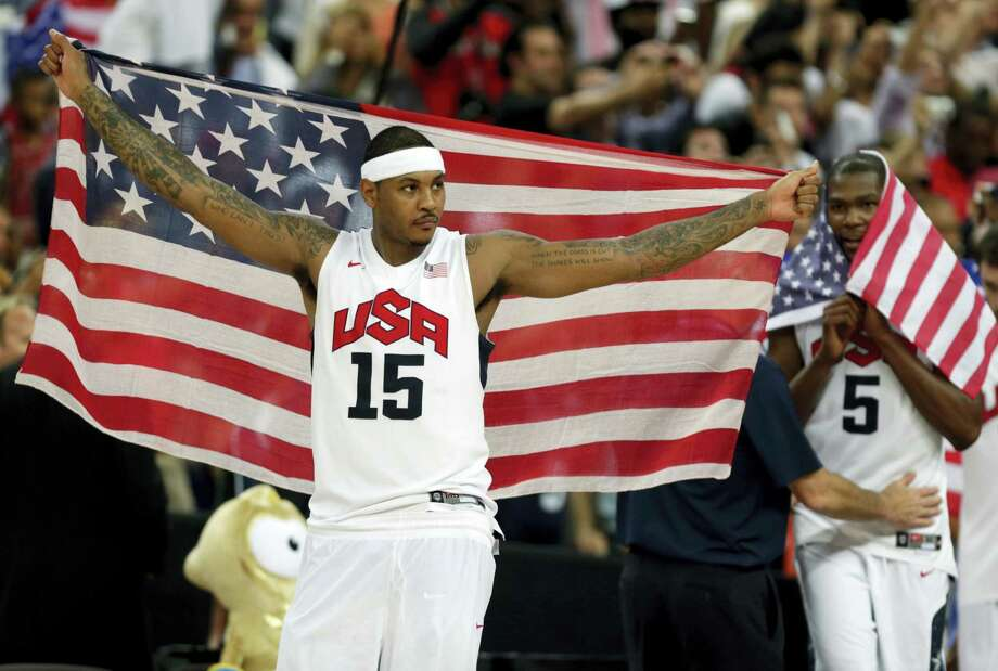 Carmelo Anthony celebrates after the men's gold medal basketball game at the 2012 Summer Olympics in London. Photo: Charles Krupa — The Associated Press File  / Copyright 2016 The Associated Press. All rights reserved. This material may not be published, broadcast, rewritten or redistribu