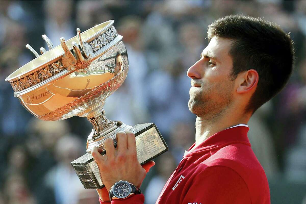 Novak Djokovic lifts up the cup after defeating Andy Murray in the men's final at the French Open on Sunday.