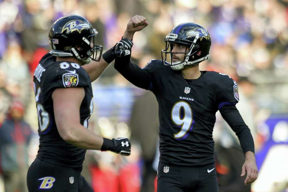 The Register's Dan Nowak likes the Baltimore Ravens to put an end to the Dolphins' six-game win streak. Photo: The Associated Press File Photo  / FR67404 AP