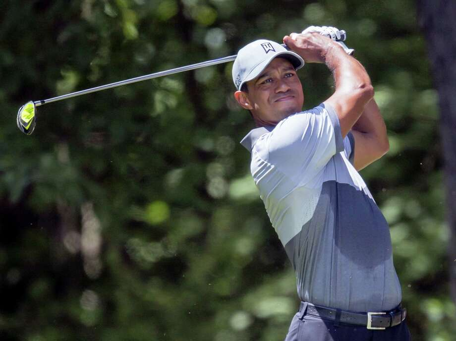 The azaleas are blooming, the pollen is swirling, and green sport coats are about to be in vogue for one whole week. Yet something is missing at this dawning of spring. Tiger Woods. Photo: The Associated Press File Photo  / FR171364 AP