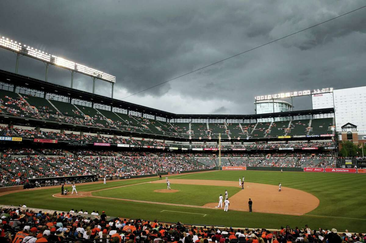 Storm clouds roll over Oriole Park at Camden Yards in the eighth inning on Sunday.