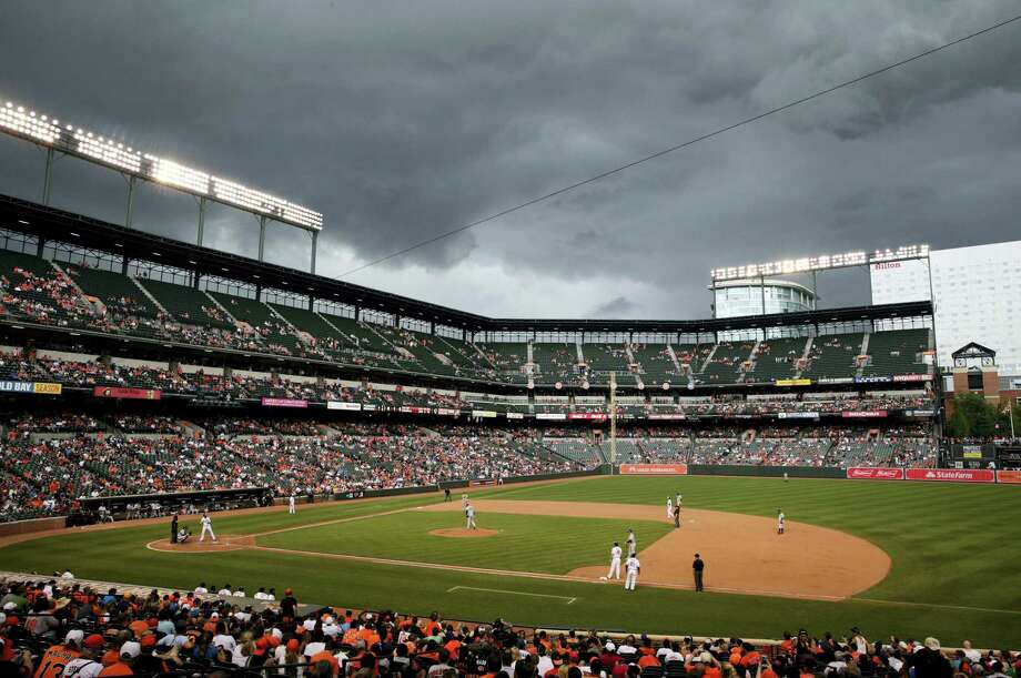 Storm clouds roll over Oriole Park at Camden Yards in the eighth inning on Sunday. Photo: Patrick Semansky — The Associated Press  / Copyright 2016 The Associated Press. All rights reserved. This material may not be published, broadcast, rewritten or redistribu
