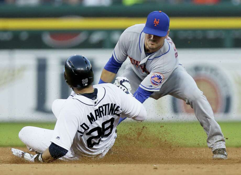 The Tigers' J.D. Martinez (28) beats the tag from Mets shortstop Matt Reynolds in the fourth inning. Photo: Duane Burleson — The Associated Press  / Duane Burleson