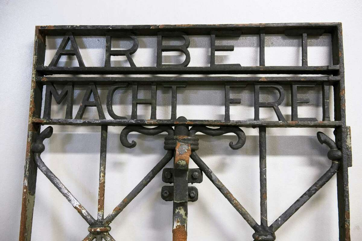 """The iron gate from the former Nazi concentration camp in Dachau, southern Germany, with the slogan """"Arbeit macht frei"""" (""""Work will set you free"""") is displayed Saturday Dec. 3, 2016, after being found earlier this week by police in Bergen, Norway. The infamous wrought iron gate was stolen two years ago, and is being cared for by police in Bergen before being returned to Germany."""