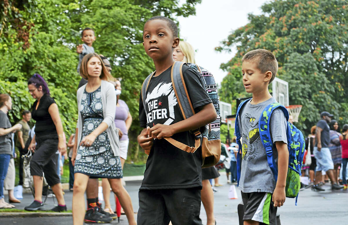 Macdonough Elementary School's first day of classes every year is a blacktop tradition — one of delight for the older children, and for the kindergartners, a mix of trepidation and apprehension.
