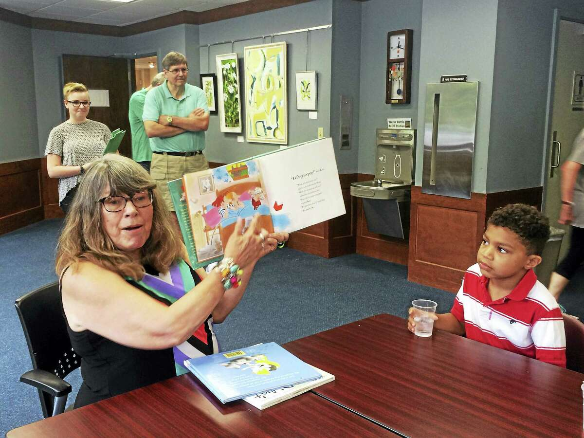 Lynn Rollo Hidek, Families Helping Families volunteer and a retired children's librarian, reads the children stories every Friday at the Henry Carter Hull Library.