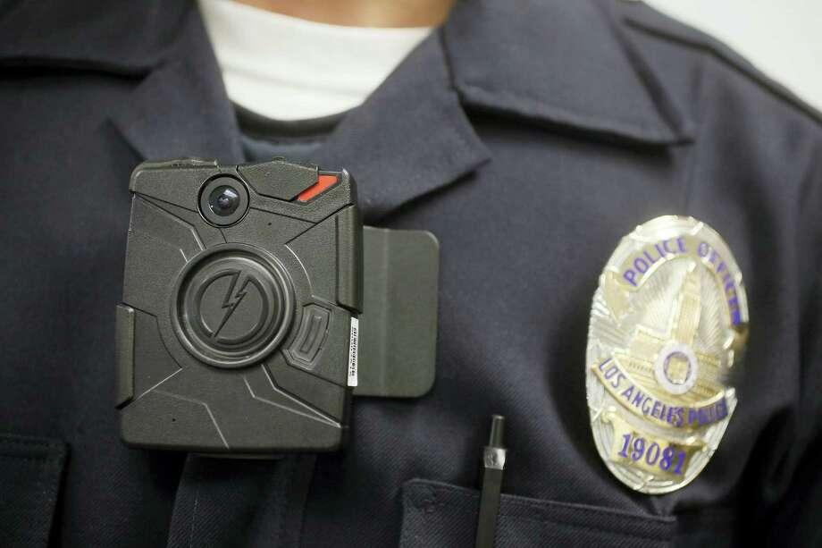 In this Jan. 15, 2014, file photo a Los Angeles Police officer wears an on-body camera during a demonstration in Los Angeles. Few Connecticut police departments are showing interest in a new state program signed into law in 2015 that requires them to begin using body cameras as of July 1, 2016. The state Office of Policy and Management tells The Associated Press that only 10 of the more than 100 law enforcement agencies in the state have contacted the agency about receiving reimbursement under the program for body camera costs. Photo: AP Photo/Damian Dovarganes, File   / Copyright 2016 The Associated Press. All rights reserved. This material may not be published, broadcast, rewritten or redistribu