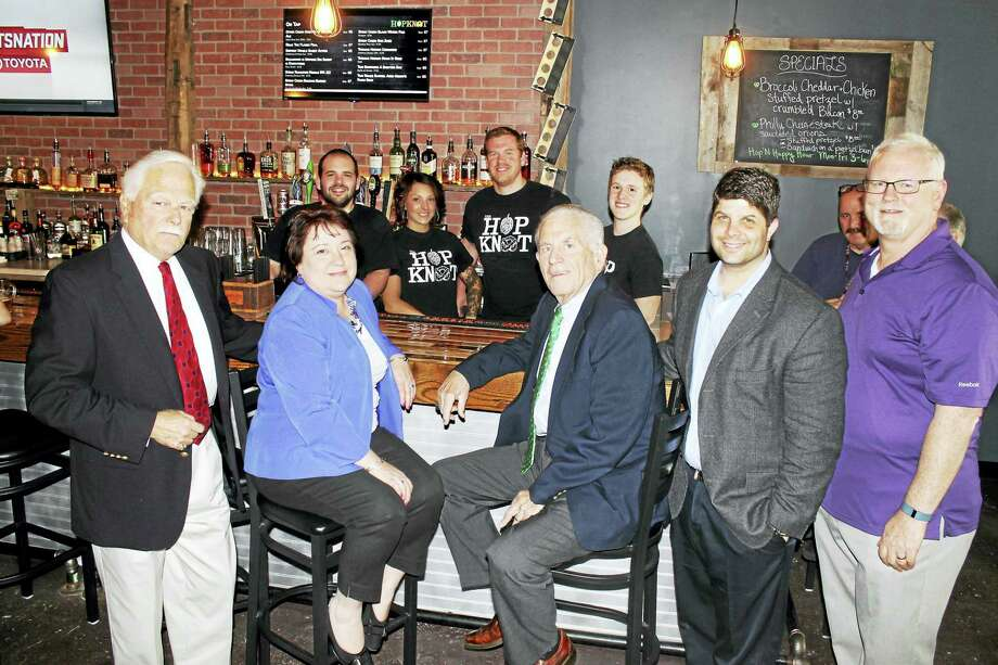 The Hop Knot held its grand opening June 2. Behind the bar, from left: general manager Anthony Calamusa, bar manager Lexi DeRota and owners John Schauster and Michael Boney. Front, from left: Middletown Small Business Development Counselor Paul Dodge, Downtown Business District chairperson Diane Gervais, McHugh, Mayor Dan Drew and Chamber Central Business Bureau Chairman Tom Byrne. Photo: Contributed Photo
