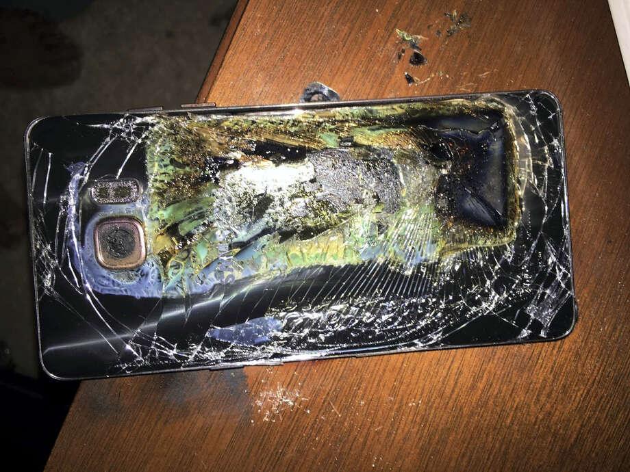 A damaged Samsung Galaxy Note 7 on a table in Richmond, Va., after it caught fire. Photo: Shawn L. Minter Via AP  / Shawn L. Minter