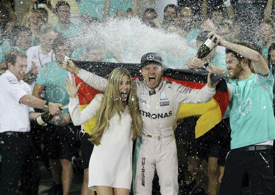 Mercedes driver Nico Rosberg of Germany, center right, is sprayed with champagne by his team after becoming the 2016 world champion in Abu Dhabi, United Arab Emirates. Photo: Kamran Jebreili — The Associated Press File  / Copyright 2016 The Associated Press. All rights reserved.