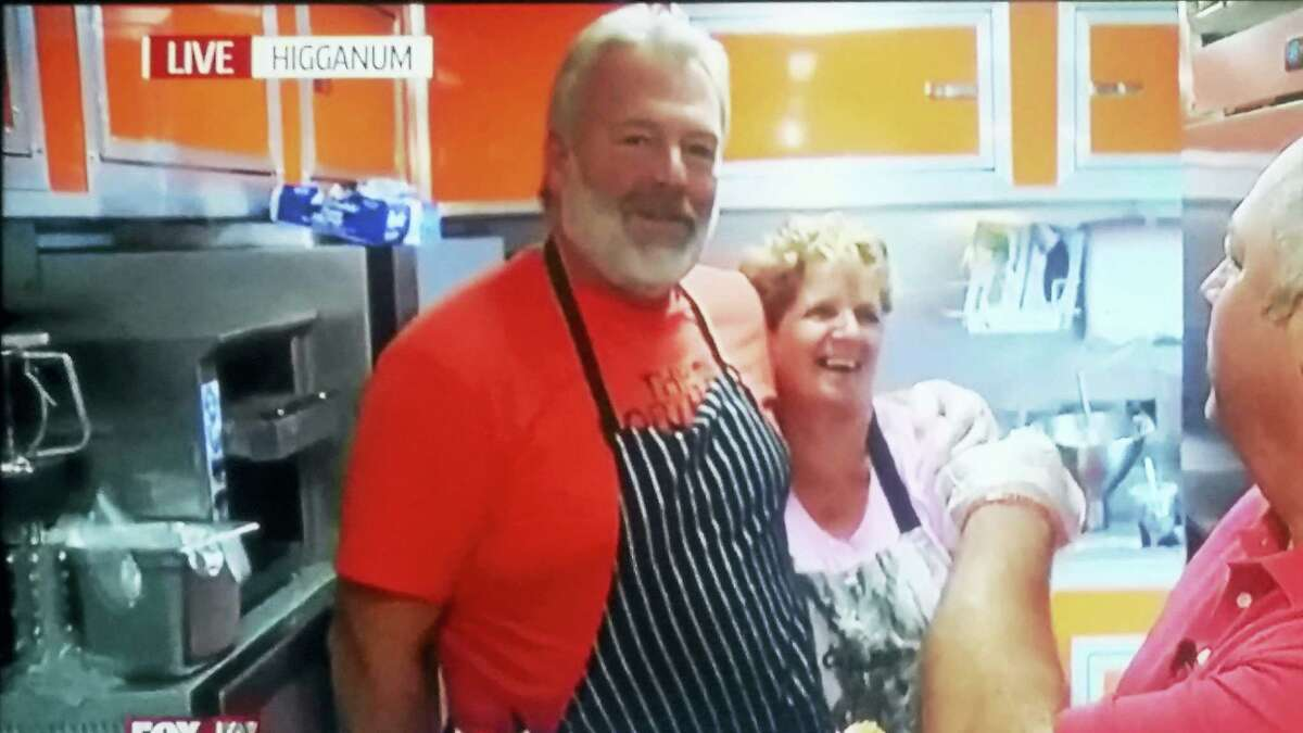 Contributed photo HK Dairy and Redneck Gourmet owner Jeff Blashke and employee Ruth Lack join a FoxCT reporter live during a Foodie Friday segment June 3. The food truck opened just a month ago and already serves a power base of hungry donut fans, drawing hundreds of customers daily.