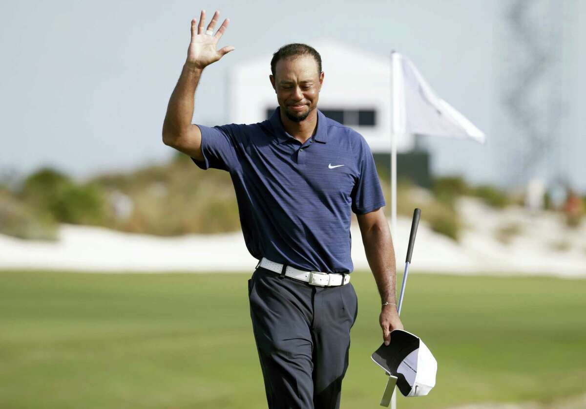 Tiger Woods waves as he walks off the 18th hole during the second round at the Hero World Challenge Friday in Nassau, Bahamas.