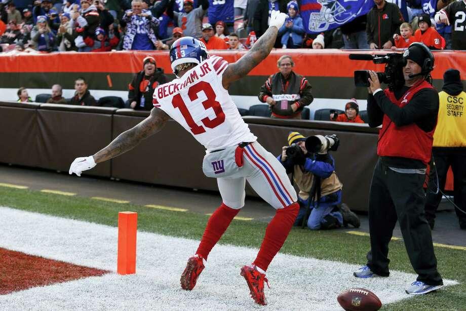 New York Giants wide receiver Odell Beckham celebrates after scoring a touchdown. Photo: Ron Schwane — The Associated Press  / AP