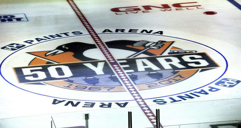 The new center ice logo is displayed with the new arena name PPG Paints Arena, formerly the Consol Energy Center, the home of the Pittsburgh Penguins NHL hockey club on Oct. 4, 2016 in Pittsburgh. Photo: Pam Panchak/Pittsburgh Post-Gazette Via AP  / Pittsburgh Post-Gazette