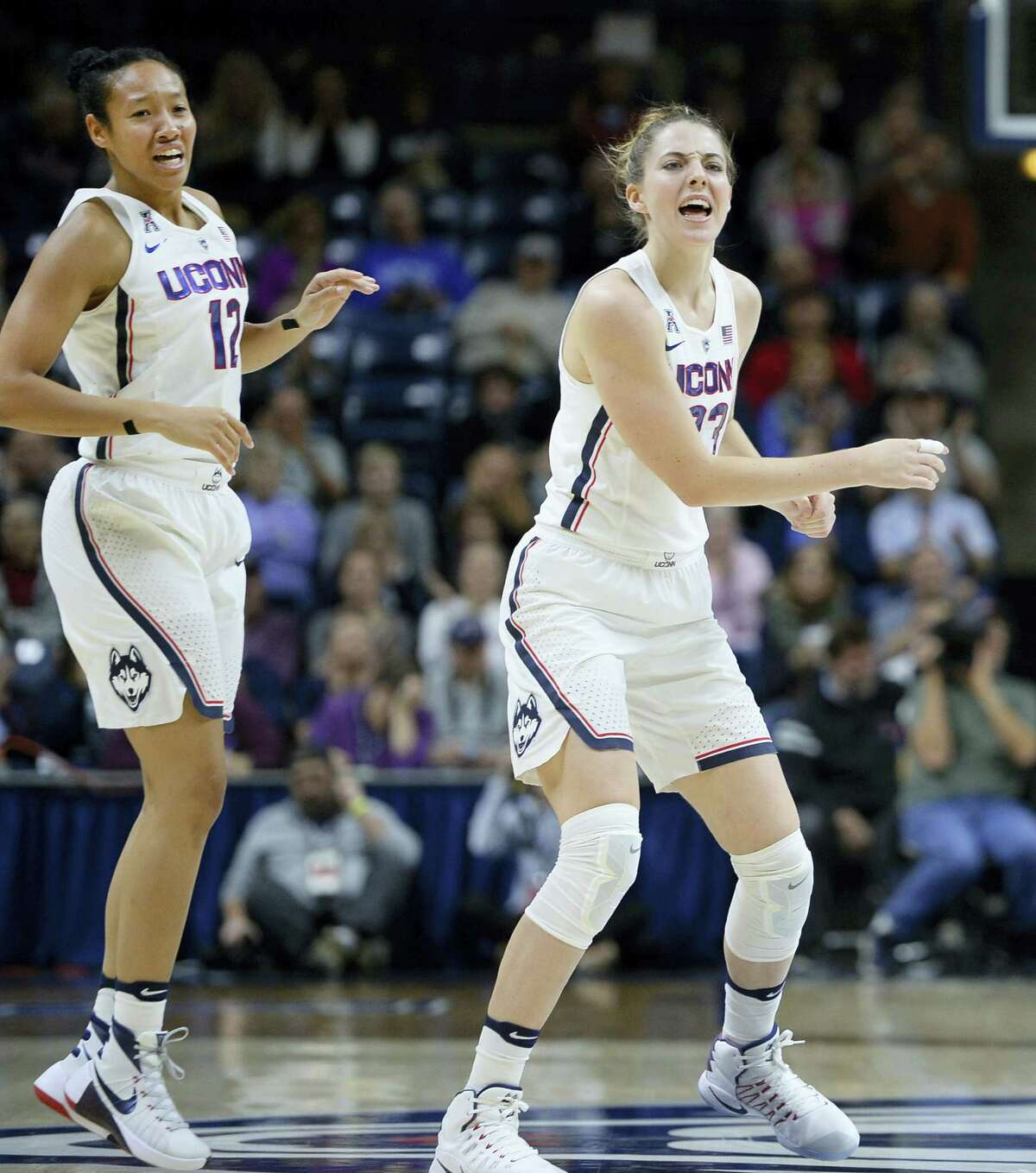 UConn's Saniya Chong, left, and Katie Lou Samuelson react during Thursday's game against DePaul.